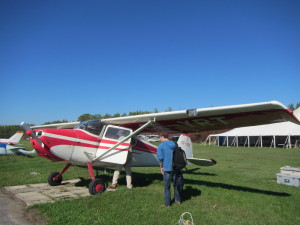 Beautiful 61 years old Cessna 170. Owned by Joe Scoles that we see in this pictures, with beside him, under the wing, Benoît Saulnier, our other crew member.